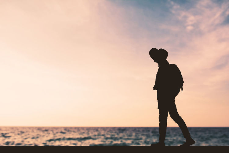 Travel Beach Day Journey Lifestyles Nature One Person Outdoors Real People Sea Silhouette Sky Standing Sunset Water