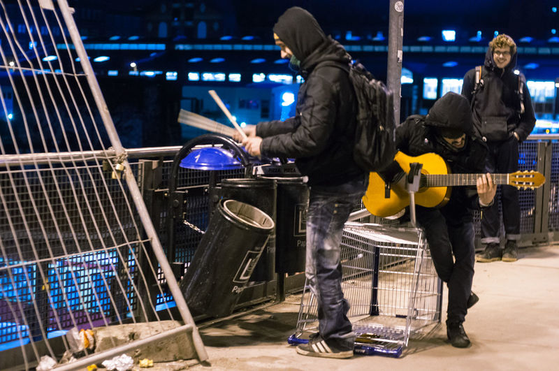 Arts Culture And Entertainment Guitar Night People Performance Adult Adults Only Only Men Headwear Outdoors City Musician One Person Acustic Guitar Playing Garbage Bin DrummingStreet Photography Streetphotography Warschauer Brücke Friedrichshain Session City Life Discover Berlin Metro Station