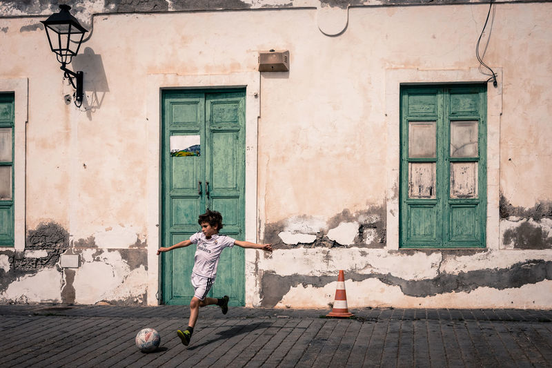 The enchantment of a simple spherical special object. Alone Ball Blanca Camiseta Bl Canary Islands Child Childhood Enchantment Everywhere Fan Football Fever Lantern Lanzarote Loneliness Niño Penta Campeones Playing Real Madrid Score Soccer Soccer Player Spaın Street Streetphotography White Shirt