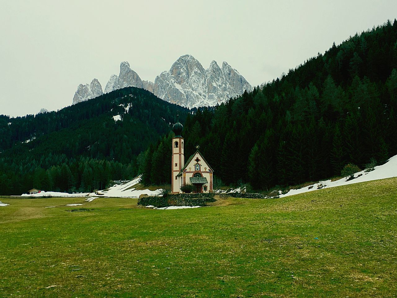 mountain, architecture, plant, sky, nature, built structure, beauty in nature, mountain range, religion, grass, building exterior, day, spirituality, scenics - nature, tree, land, belief, place of worship, building, field, no people, outdoors