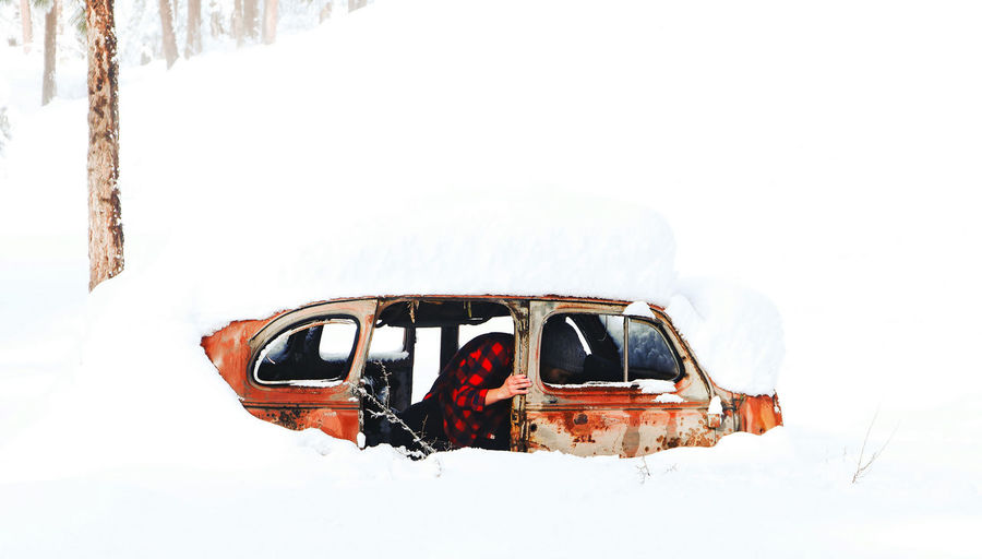 Exploring a broken old car in the woods. Vintage Flannel Flannel Shirt Active Lifestyle  Exploring Rust Rusty Vintage Cars Vintage Style No Face Snowscape SnowField Vintage Style Winter Activities Snowstorm Antique Antique Car Forgotten Forgotten Places  Adult Adults Only People Day Outdoors One Person Cold Temperature Portrait Young Adult Snow Winter Shades Of Winter An Eye For Travel Visual Creativity Holiday Moments Humanity Meets Technology