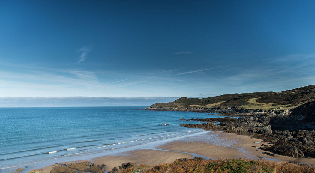 Woolacombe Beach - Devon Beach Beauty In Nature Blue Calm Coast Coastline Coastline England Horizon Over Water Idyllic Landscape Nature Scenics Sea Seascape Shore Summer Tourism Tranquil Scene Tranquility Travel Destinations Vacations Water Woolacombe Woolacombe, Devon Pet Portraits