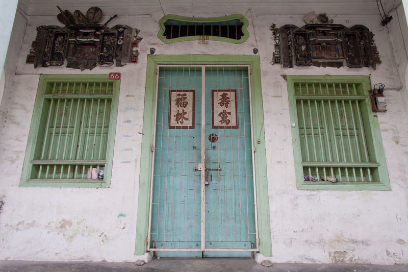 Low angle view of closed door of building
