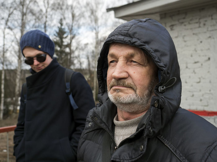 Man looking at father during winter