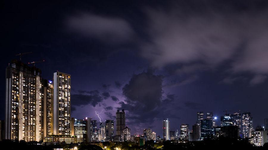 Panoramic view of illuminated city against sky at night