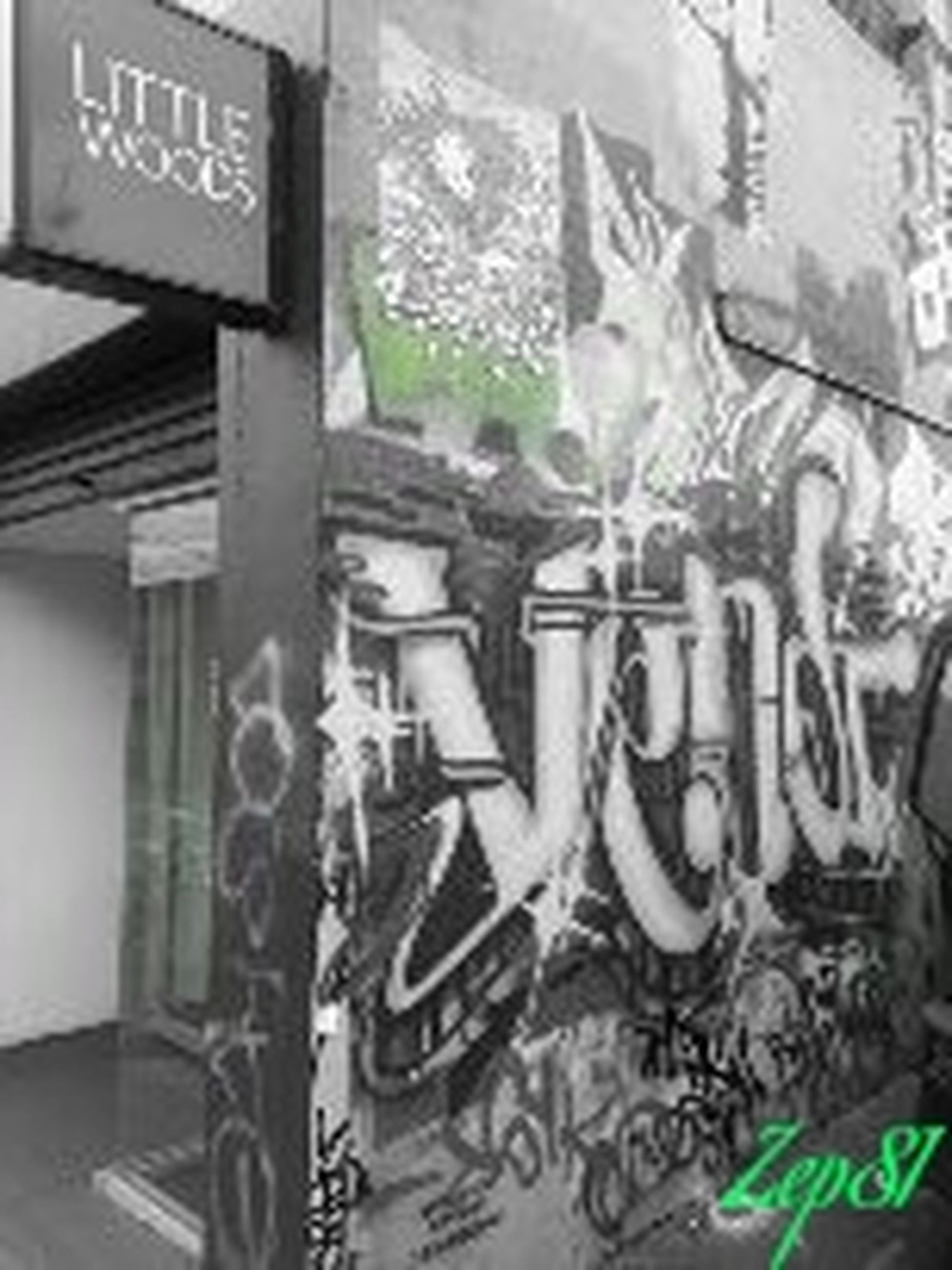 text, western script, communication, architecture, built structure, building exterior, graffiti, city, wall - building feature, non-western script, indoors, window, no people, information sign, day, sign, building, street, close-up
