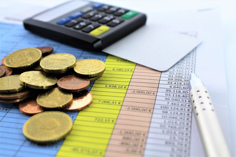An concept image of a spreadsheet Business Business Finance And Industry Calculater Calculation Calculations Calculator Close-up Coin Coins Colorful Concept Day Finance Indoors  Money No People Numbers Pen Pink Color Spreadsheet