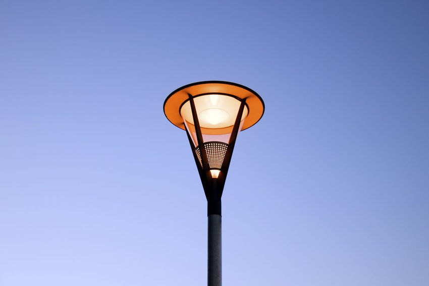 Lighting Equipment Sky Street Light Illuminated Electricity  Street Clear Sky Blue Low Angle View Light Electric Light Glowing No People Copy Space Nature Light - Natural Phenomenon Outdoors Pole Electric Lamp Fuel And Power Generation Electrical Equipment