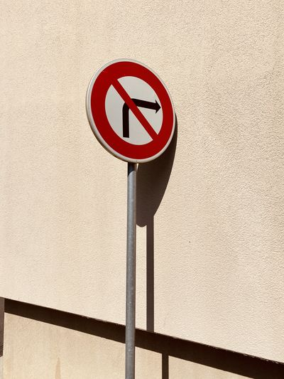 Road sign on wall