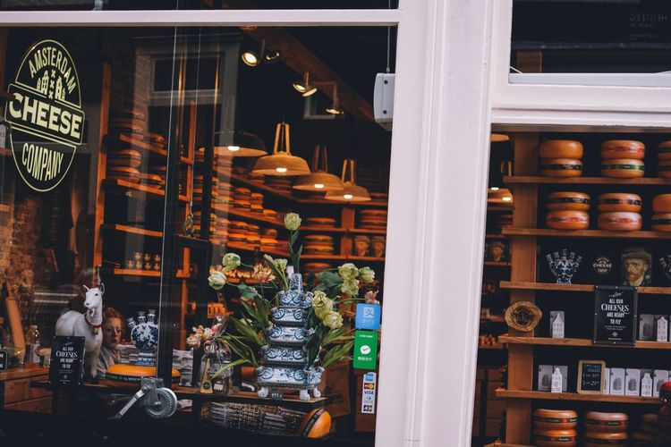 Amsterdam Store Retail  Variation Shopping Arrangement Choice For Sale Transparent Collection Glass - Material Large Group Of Objects Retail Display Shelf Sale Illuminated One Person Window Real People Business Night Consumerism