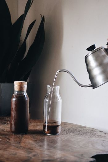 Coldbrew Cold Drink Craft Photography Container Bottle Indoors  Table Still Life No People Close-up Glass - Material Wall - Building Feature Plant Household Equipment Nature Metal Wood - Material Home Interior Transparent Jar Shelf Variation