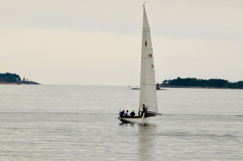 Sailing in the early morning rain Nautical Vessel Water Transportation Mode Of Transportation Sky Waterfront Sea Group Of People Real People Sailing Sailboat Incidental People Travel Men Nature Scenics - Nature Outdoors Lifestyles Day