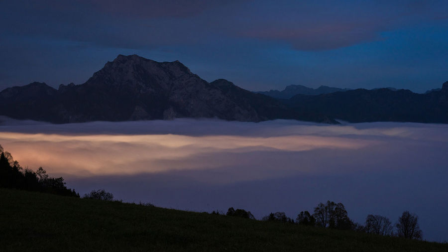 Nebel Nebelmeer Lichter Abendstimmung Sky Scenics - Nature Tranquil Scene Beauty In Nature Tranquility Mountain Cloud - Sky Landscape Environment No People Non-urban Scene Nature Idyllic Tree Mountain Range Sunset Plant Silhouette Night Dusk Outdoors