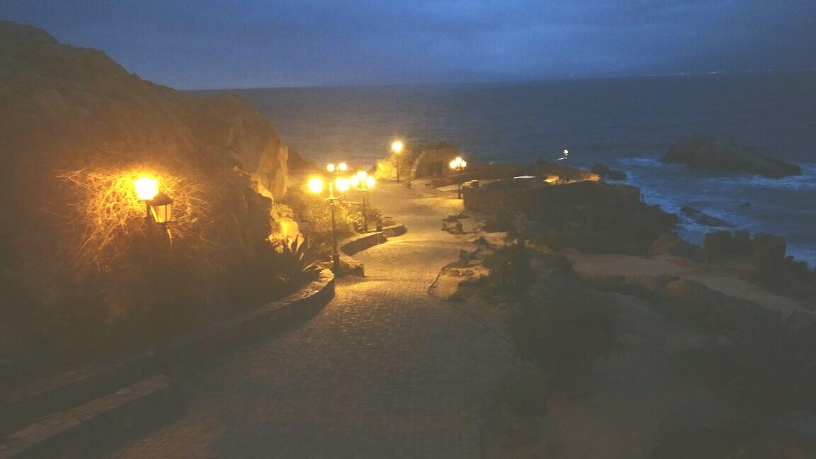 sea, illuminated, nature, night, outdoors, no people, sky, beauty in nature, water, horizon over water