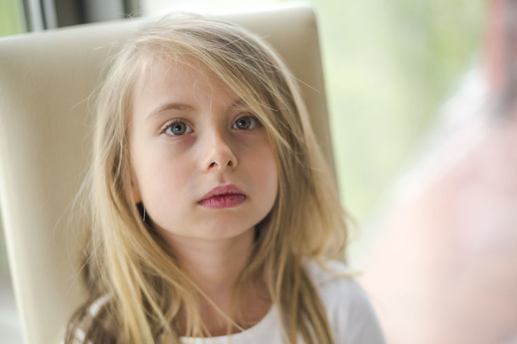 Child Portrait Childhood Headshot Girls Hair Women Females Blond Hair One Person Front View Lifestyles Focus On Foreground Innocence Indoors  Selective Focus Cute Hairstyle Contemplation Making A Face Human Face