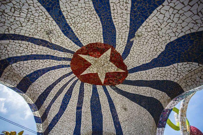 Cuban flag made from a mosaic of broken tiles in Havana, Cuba. Cuban Flag Havana, Cuba Travel Beauty Bestdestinations Close-up Day Fusterlandia Jaimanitas Nature No People Outdoors Patriotism Pattern Shadow Sunlight Surrealism Travel Destinations