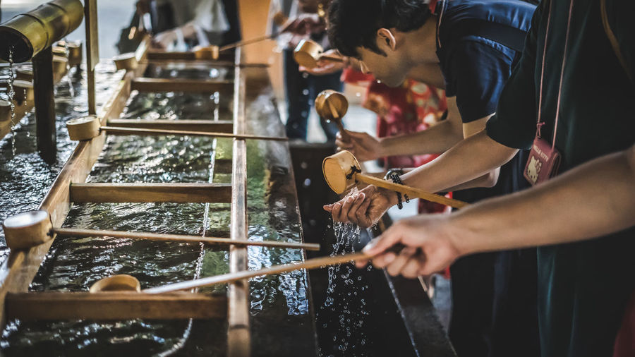 Holy water japan Holy Water Japan Japan Photography Japanese  Japanese Culture Japanese Style Japanese Temple Culture Cultures Food Food And Drink Hand High Angle View Holding Holy Human Body Part Human Hand Indoors  Japanese Food Lifestyles Midsection People Preparation  Preparing Food Real People