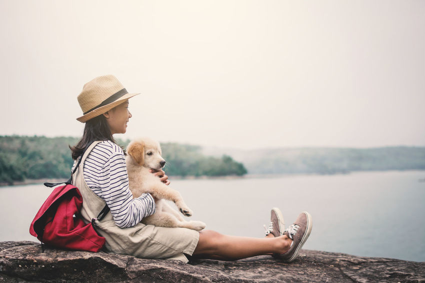 Happiness Nature Relaxing Travel Bag Cute Dog Girl Hat Little Mammal One Animal One Person Pets Playing Water Adventures In The City