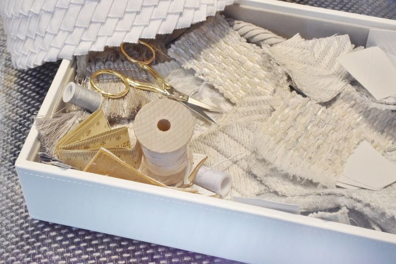 High angle view of sewing items in container on table