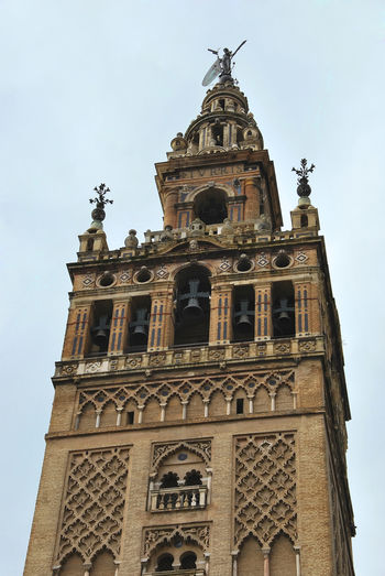Giralda SPAIN Sevilla Architecture Belief Bell Tower Bellfry Building Exterior Day Giraldillo History Low Angle View Nature No People Ornate Outdoors Place Of Worship Religion Sky Spire  Spirituality The Past Tower Travel Destinations