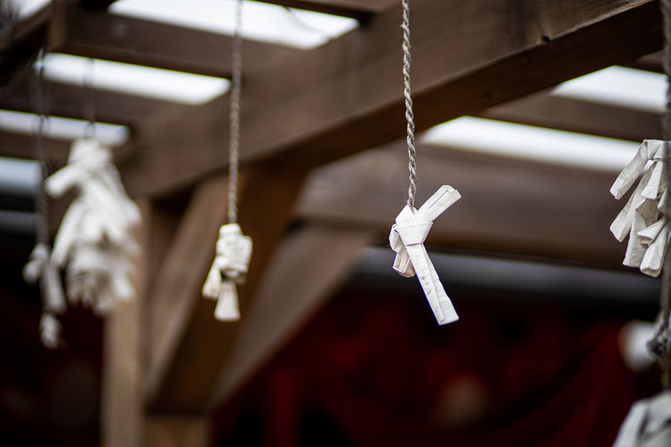 Close-up of cross hanging on rope