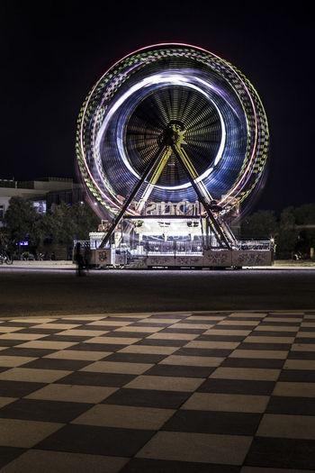 Ferris wheel in city at night