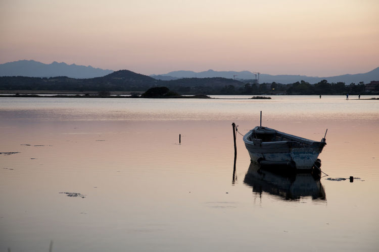 Beauty In Nature Clear Sky Day Lake Mode Of Transport Moored Mountain Mountain Range Nature Nautical Vessel No People Outdoors Reflection Scenics Sea Sea And Sky Seascape Sky Sunset Tranquil Scene Tranquility Transportation Water