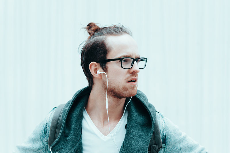 Young men listen music Earphones Leipzig Casual Clothing Close-up Coolness Day Denim Eyeglasses  Headshot Hipstamatic Hipster Leisure Activity Lifestyles Men Menfashion Music One Person Portrait Real People Young Adult Young Men