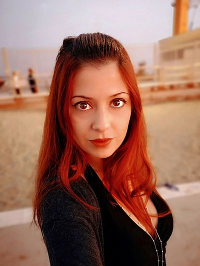 Portrait Of Beautiful Young Woman With Redhead