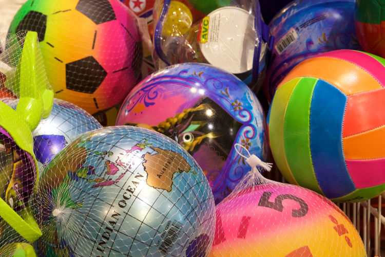 A shop display of brightly coloured balls. Backgrounds Balls Beach Life Bright Colors Brightly Coloured Footballs Multi Colored No People Play Shop Display Variation