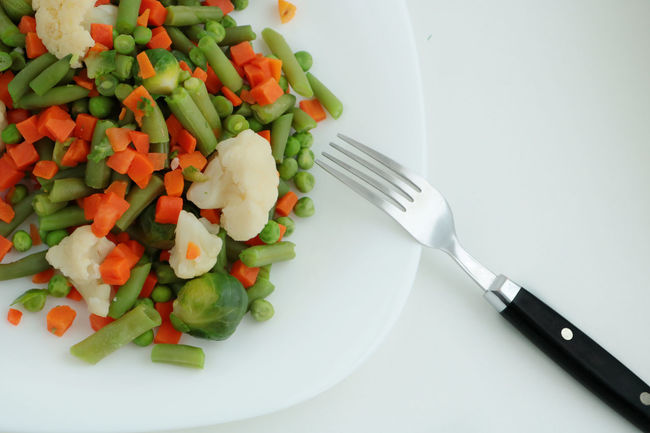 Beans Breakfast Broccoli Cabbage Carrots Cauliflower Close-up Day Dinner Food Food And Drink Fork Freshness Healthy Healthy Eating Healthy Food Healthy Lifestyle Indoors  Knife No People Ready-to-eat Table Tablecloth Vegetable White Background