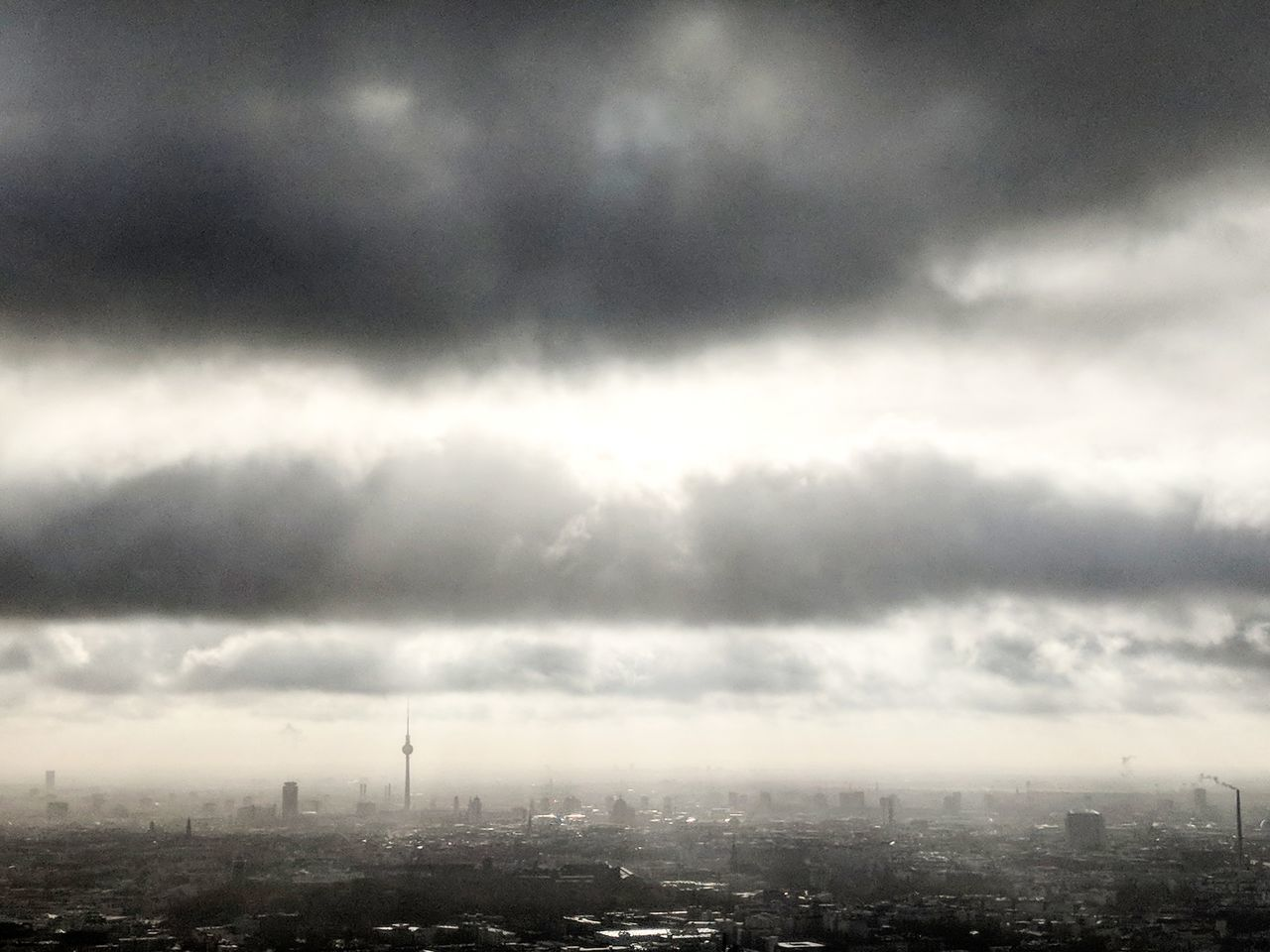 cityscape, city, architecture, sky, building exterior, cloud - sky, built structure, weather, no people, outdoors, storm cloud, day, nature, modern, skyscraper, beauty in nature
