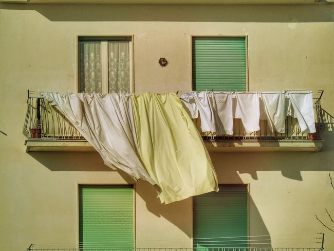 Laundry Window Hanging Drying Clothesline Built Structure No People Clothing Architecture Towel Yellow Residential Building Building Exterior Day Hygiene Textile Home Interior Coathanger Indoors  Balcony Wind Streetphotography The Street Photographer - 2017 EyeEm Awards