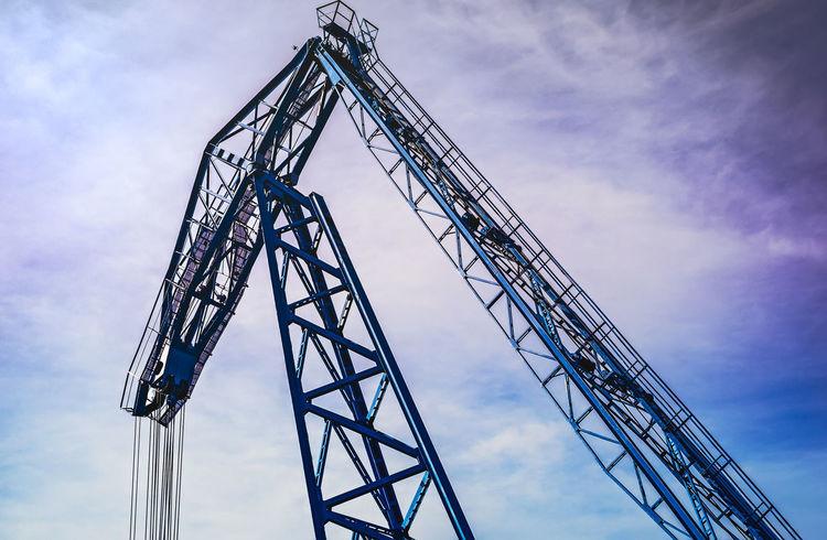 Blue crane Blue Crane Architecture Arts Culture And Entertainment Built Structure Cloud - Sky Crane Crane - Construction Machinery Crane Truck Day Low Angle View No People Outdoors Sky Technology