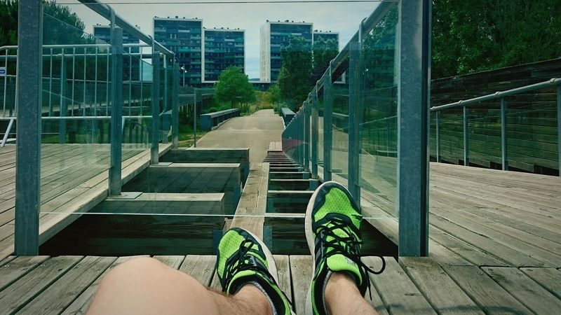 Sitting on the city Out Of The Box Urban One Person Shoe Personal Perspective Day Outdoors Sportswear Low Section Human Leg Human Body Part Bridge - Man Made Structure One Woman Only Adults Only Lifestyles Adult Only Women Leisure Activity Standing People Footbridge Real People City