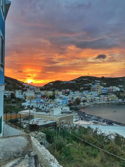 Sunset on wild island Sea Island Italy Ponza Sunset Water Sky Cloud - Sky Architecture Nature City Building Exterior Orange Color Beauty In Nature Scenics - Nature Built Structure Building No People Sea Nautical Vessel Reflection Cityscape Outdoors
