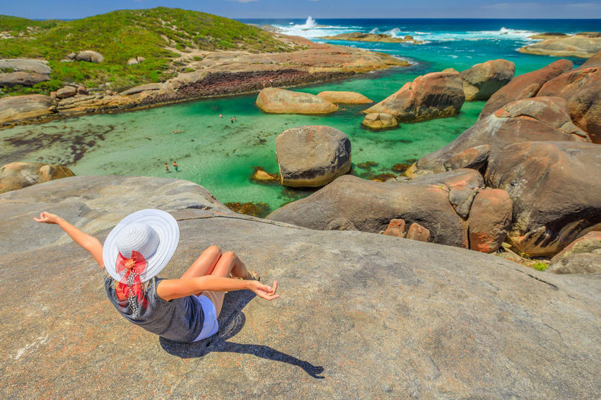 Woman sitting on the cliffs above elephant-shaped rocks of Elephant Rocks in Denmark, Western Australia. Happy tourist looking Great Southern Ocean in William Bay NP. Summer destination in Australia. William Bay National Park National Park Western Australia Western Australia Beaches Australia Denmark Sea Beach Tourism Travel Destinations Vacations Nature Sand Stones Cliff Rocks Boulders Elephant Cove Snorkeling Photo Diving Swimming Natural Pool Woman Female Girl Water Rock Solid Rock - Object One Person Full Length Leisure Activity Real People Day Lifestyles Beauty In Nature Casual Clothing Holiday