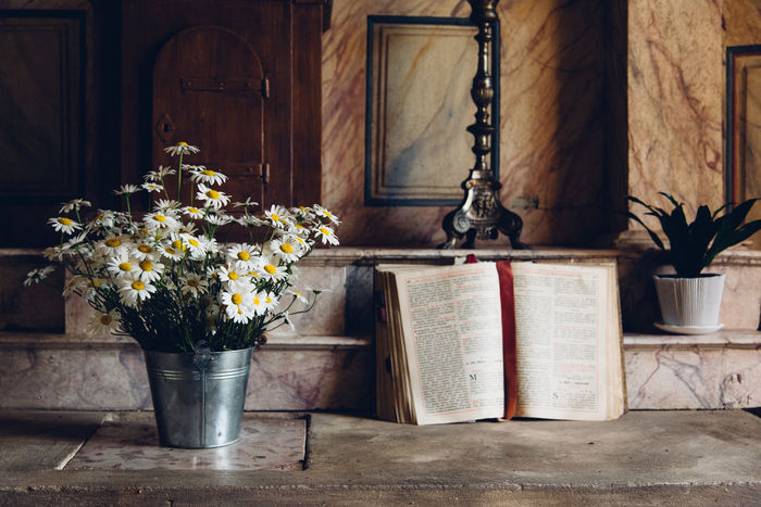 Altar Bible Catholicism Catholic Religion Place Of Worship Flowerpot Bouquet Calm Serenity Flower Flowering Plant Plant No People Table Potted Plant Indoors  Nature Book Publication Wood - Material Vase Day Architecture Fragility Freshness Close-up Beauty In Nature Flower Pot Flower Arrangement Flower Head
