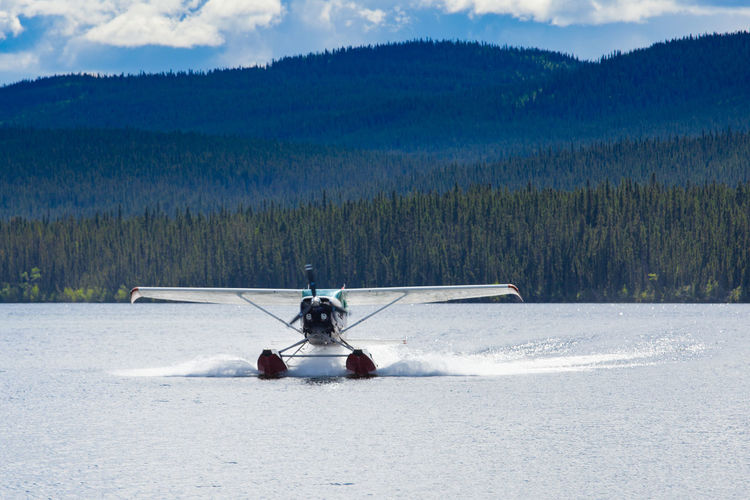 Float plane landing on remote wilderness lake in boreal forest taiga of Yukon Territory, Canada Float Plane Floatplane Landing Landing Plane Landing - Touching Down Water Lake Remote Travel Trip Wilderness Yukon Yukon Territory Canada Boreal Forest Taiga Forest Landscape Transportation Nature Mode Of Transportation Air Vehicle Outdoors Airplane No People Aerospace Industry Non-urban Scene The Traveler - 2019 EyeEm Awards