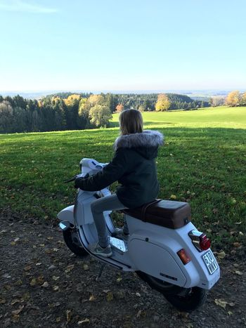 Field Nature Real People One Person Leisure Activity Tree Rear View Day Full Length Sitting Landscape Women Tranquility Lifestyles Beauty In Nature Grass Outdoors Clear Sky Sky Scenics Vespa