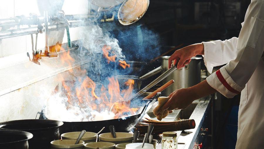 Man working in kitchen at restaurant