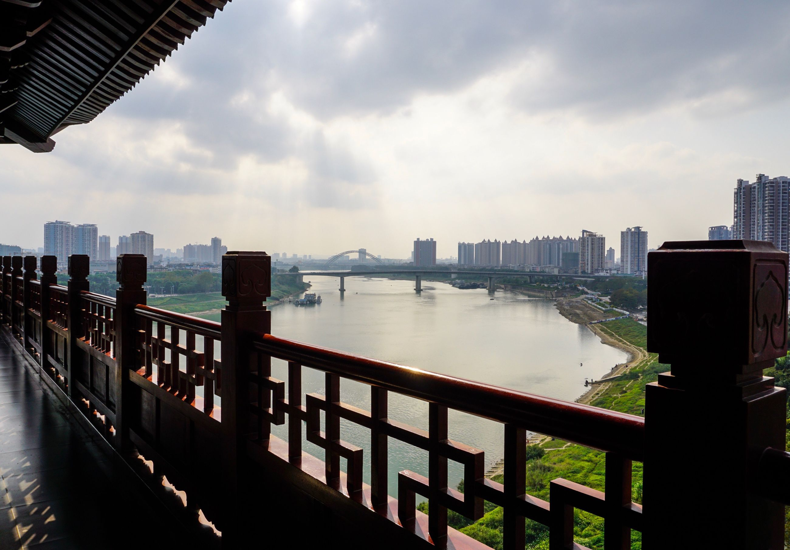 water, railing, city, river, architecture, building exterior, built structure, sky, connection, bridge, cloud, bridge - man made structure, cityscape, sea, cloud - sky, engineering, outdoors, day, city life, skyscraper, tranquility, waterfront, scenics, tranquil scene, modern, tourism, no people, urban skyline