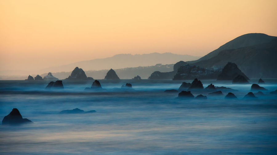 Long exposure sea stacks and mist at Dillon Beach, CA. Sea Water Sunset Nature Sky Fog Outdoors Rock Tranquility Long Exposure Mountain Waterfront Split Tone Beauty In Nature Waves And Rocks Solid Bodega Bay No People Idyllic Tranquil Scene Non-urban Scene Rock - Object Dillon Beach, CA Scenics - Nature Sonoma Coast