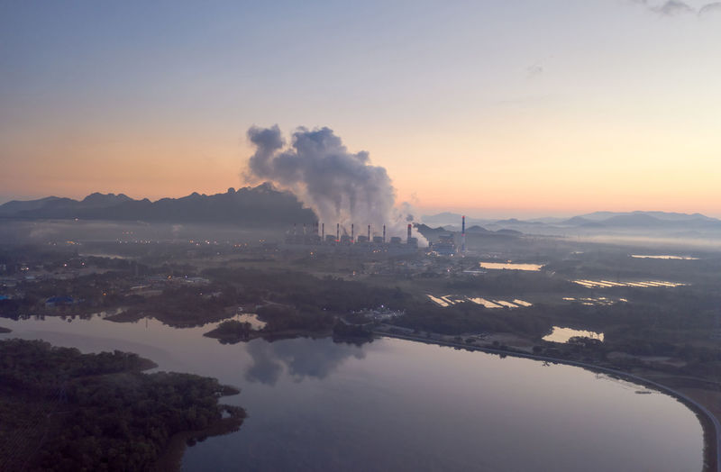 Aerial view steam fumes above the coal power plant. mae moh, lampang, thailand.