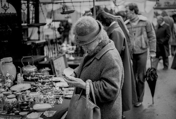 Senior woman standing at market stall