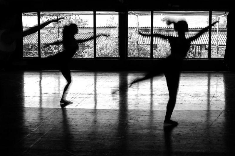 Silhouette Of Dancers In Studio