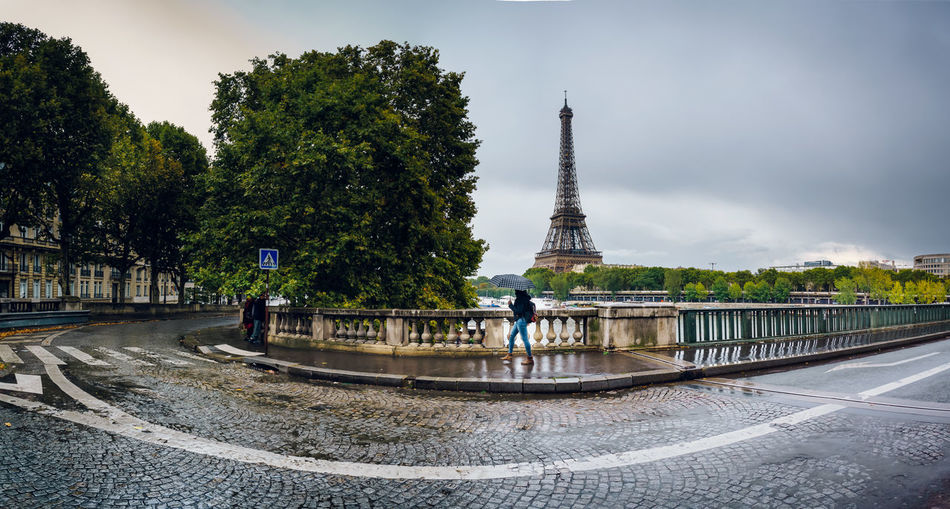 A rainny day in Paris 2017 European  Seine River Tour Eiffel Tree Architecture Building Exterior Built Structure City Cityscape Clouds And Sky Day Eurotrip No People Outdoors Sky Streetphotography Tower Travel Travel Destinations Tree