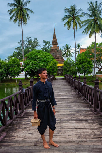 Thai Guy with Thai uniform because we come to Historical park go! in the past Religion History Spirituality Tree Business Finance And Industry Walking Travel Destinations Adult People Mature Adult One Person Architecture City Smiling Outdoors Full Length Adults Only Day Young Adult Sky Uniforms Thailand🇹🇭 Bridge One Man Only Only Men