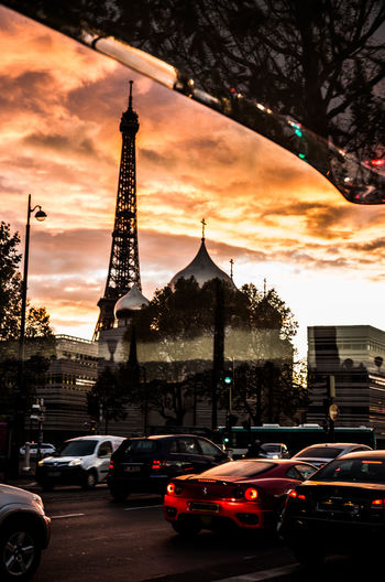 waiting at a busstop in Paris Eiffel Tower Paris Beauty. Paris Sunset Reflection The Traveler - 2018 EyeEm Awards The Week on EyeEm Car City Cloud - Sky Mode Of Transportation Motor Vehicle No People Orange Color Orange Hour Paris From A Busstation Sundown Paris Sunset Traffic Paris Transportation Travel Destinations #urbanana: The Urban Playground