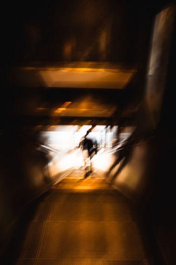 Blurred motion of man walking in train